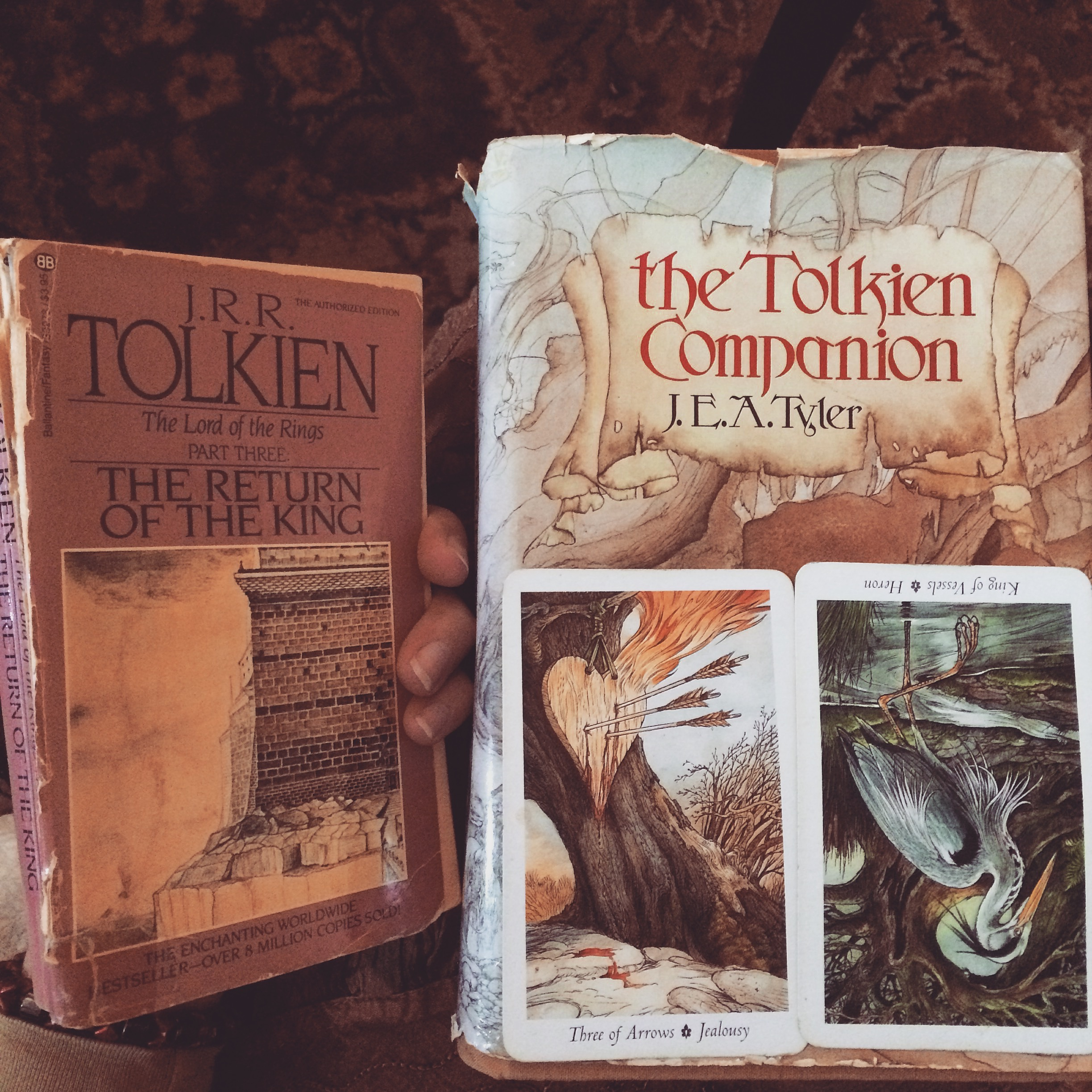 two tarot cards and two tolkien books